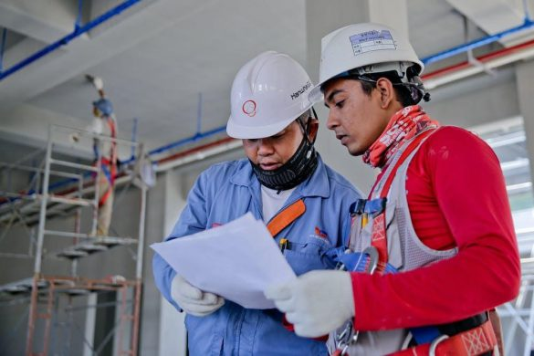 2 CAD Engineers Engineers Reading a Document